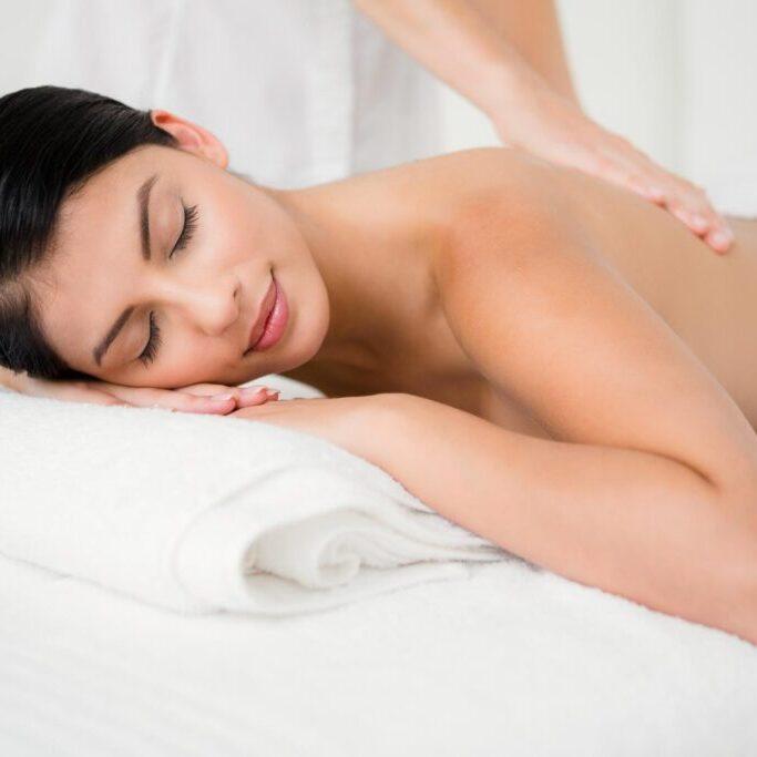 woman lying having a back massage