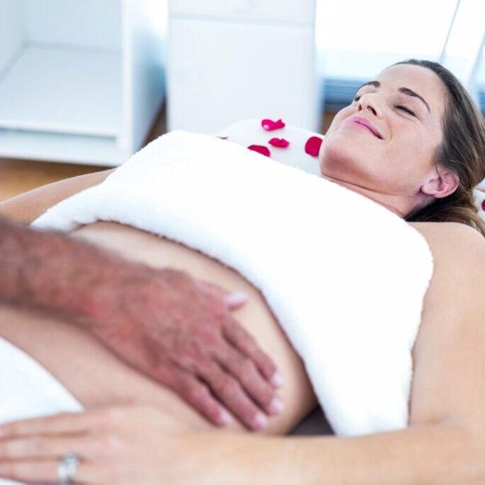 woman having abdomen massage
