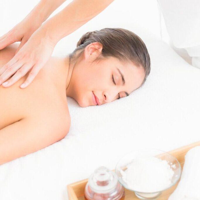 woman having back massage treatment